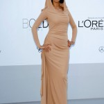 Malika sherawat Covers up at Cannes 2012