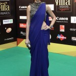 Nargis fakri dons a beautiful blue saree at IIFA awards green carpet 2012