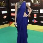 Nargis fakri dons a beautiful blue saree at IIFA awards green carpet 2012