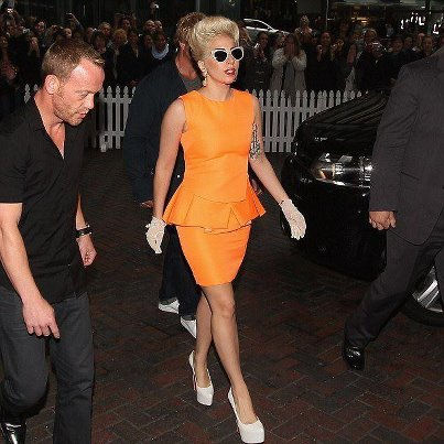 Lady gaga in orange peplum dress orange colour trends 2012 fashion