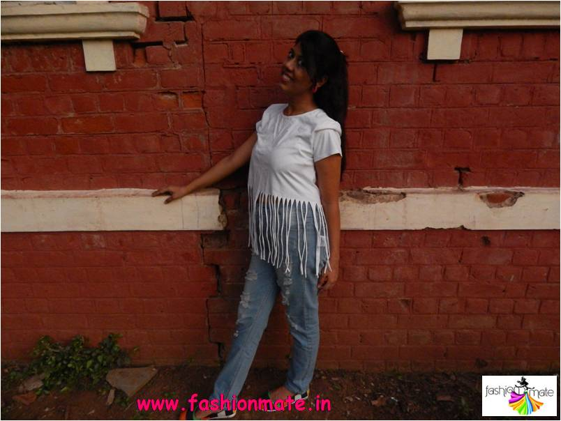 How to style fringed top with ripped denims- fashion trends