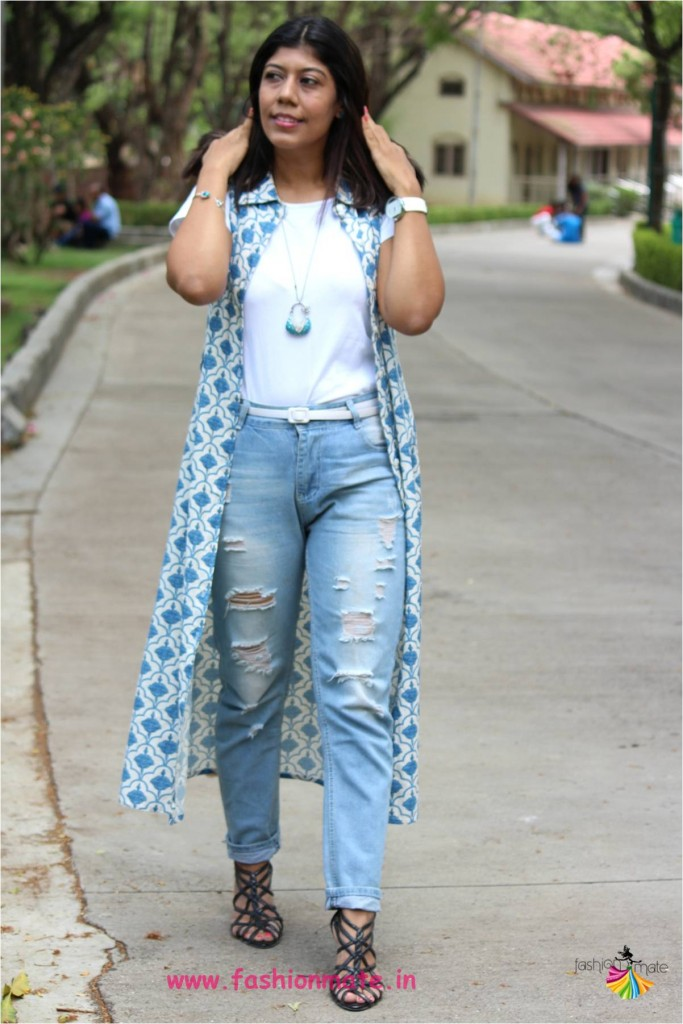 Street fashion - college girl style in cape and distressed denims