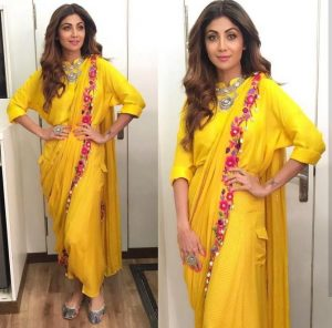 yellow dhoti saree - stylish haldi outfit for sister of bride 2018